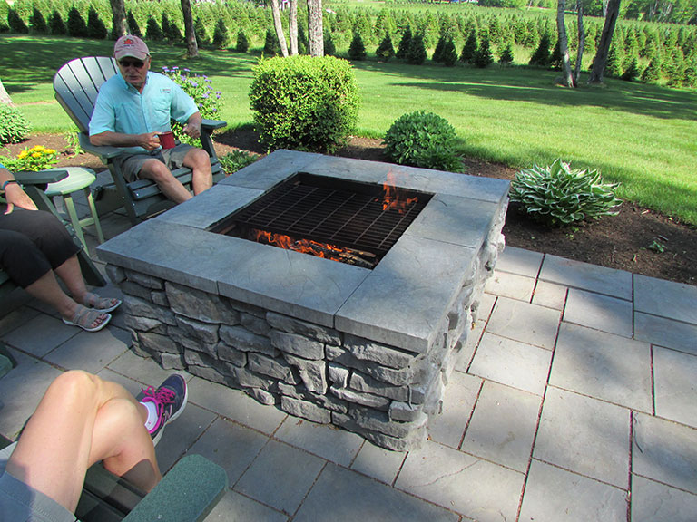 As an added outdoor entertainment feature, Redi-Rock® of Central Maine  manufactures and sells an outdoor fire pit. With a beautiful natural stone  appearance ... - Redi-Rock(r) Of Central Maine Is A Maine Manufactures And